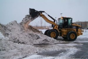 Heavy Equipment Moving Snow
