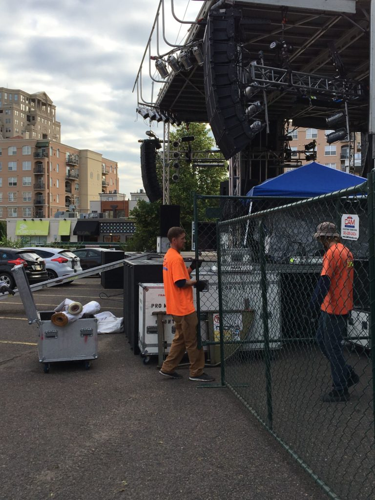 CAM Team members setting up temporary fencing at a music festival